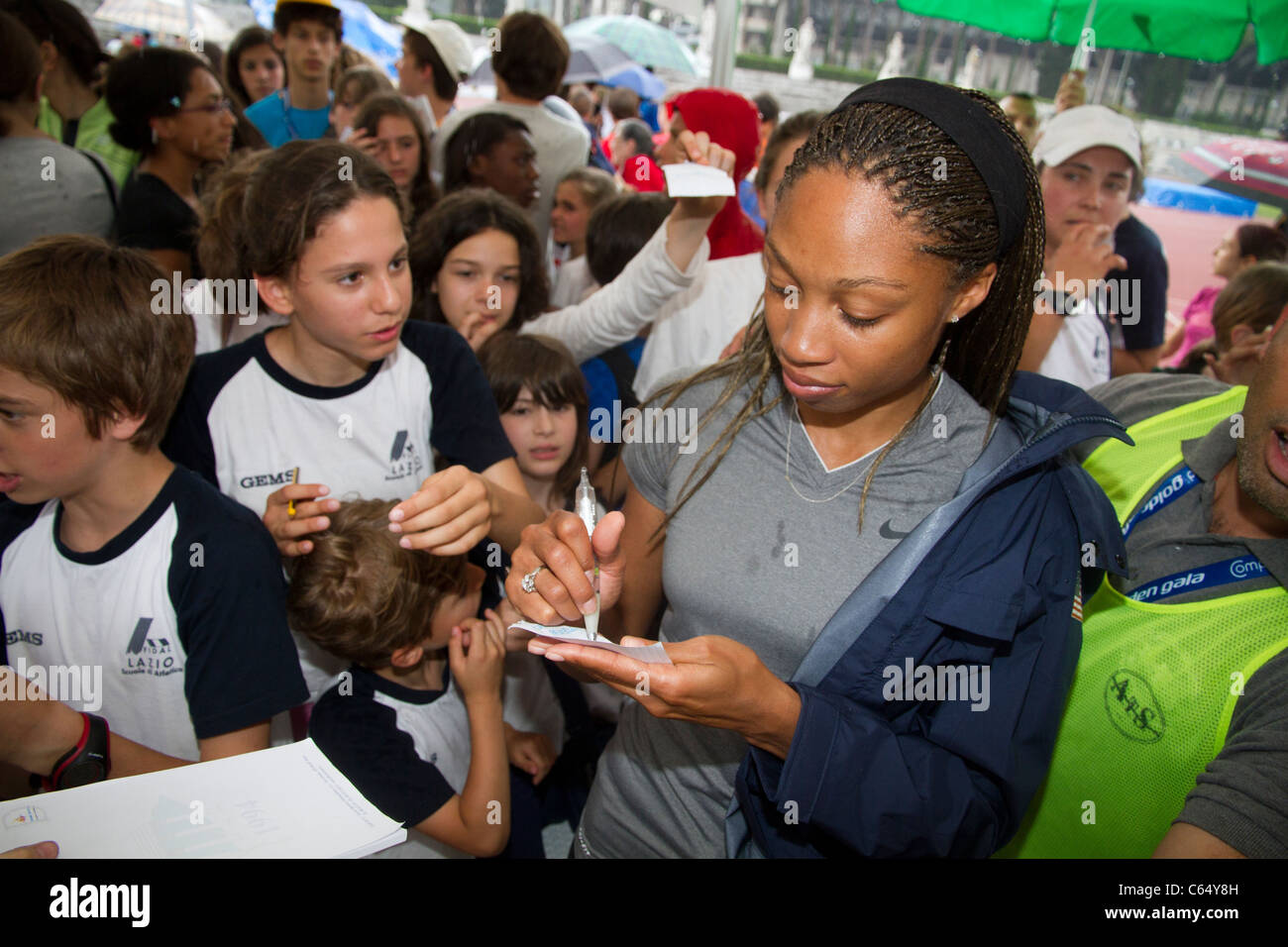 Allyson Felix athlete signing autographs for fans before the Golden Gala of Rome 2011 - Stock Image