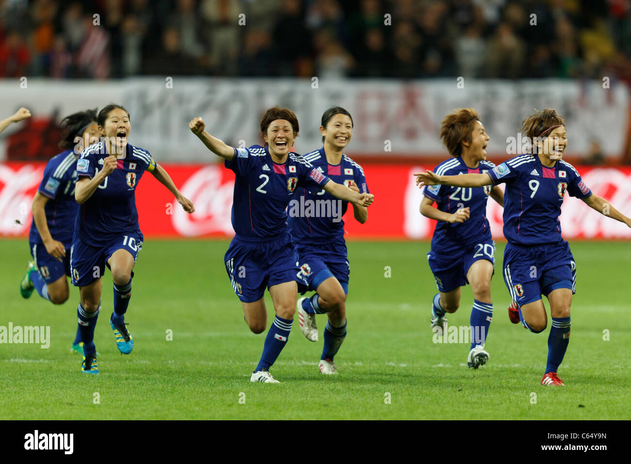 Japanese players react after beating the United States on penalty kicks to win the 2011 FIFA Women's World Cup - Stock Image