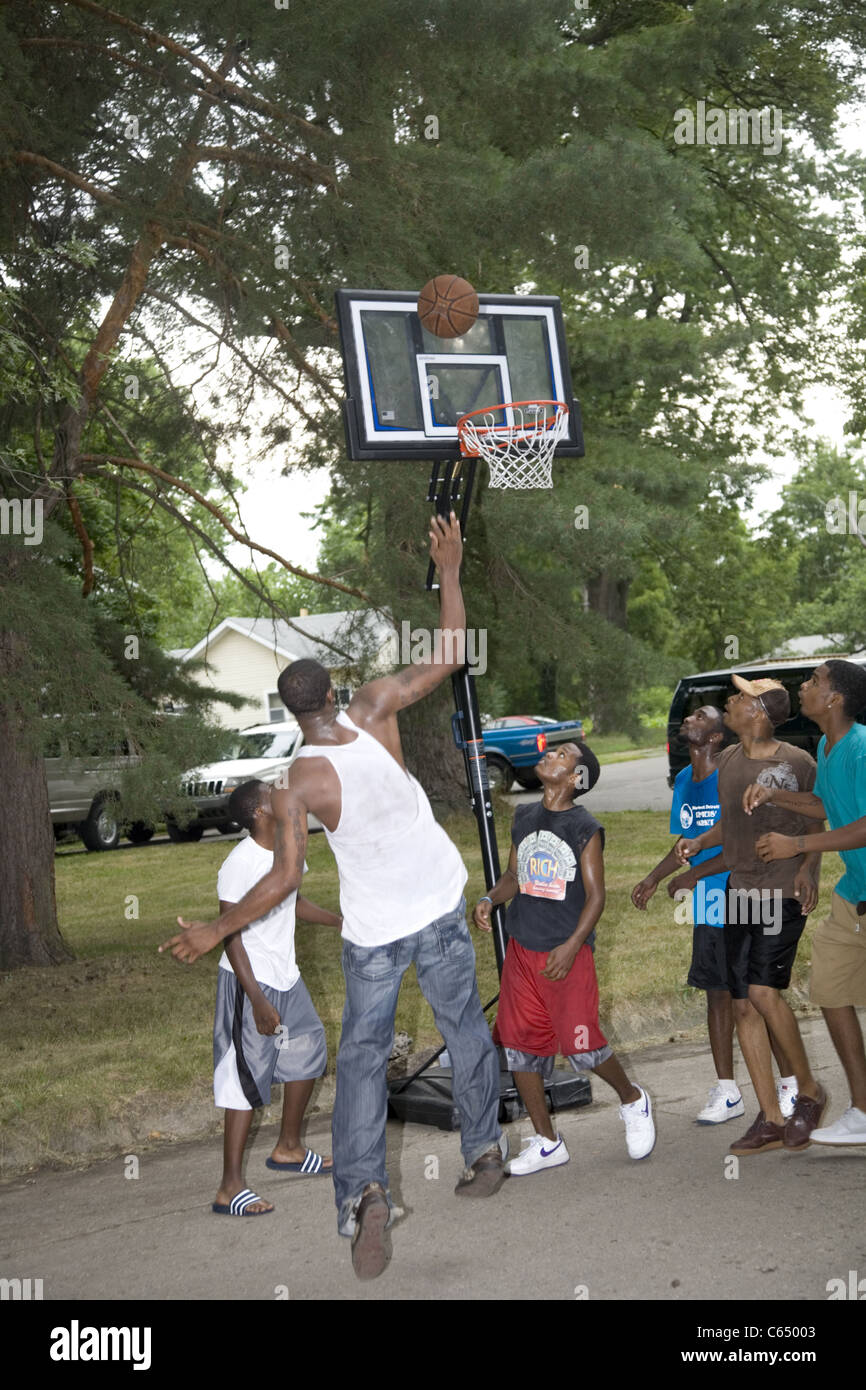Boys play a pick-up game of street basketball in the Brightmoor neighborhood, Detroit, MI. Stock Photo
