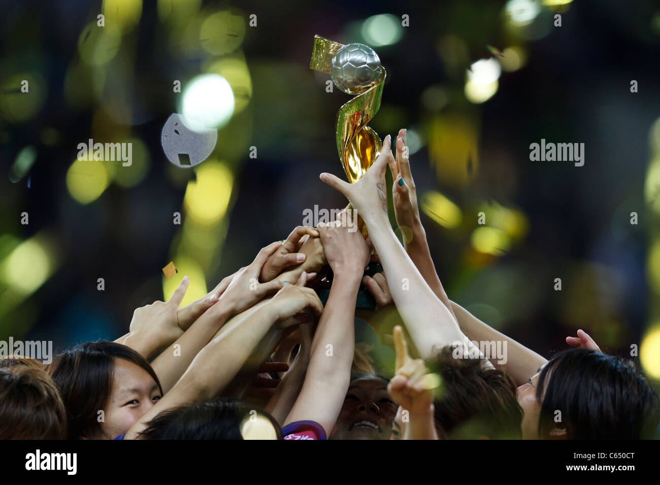 Japanese players hoist the World Cup trophy after defeating the USA to win the FIFA Women's World Cup final - Stock Image