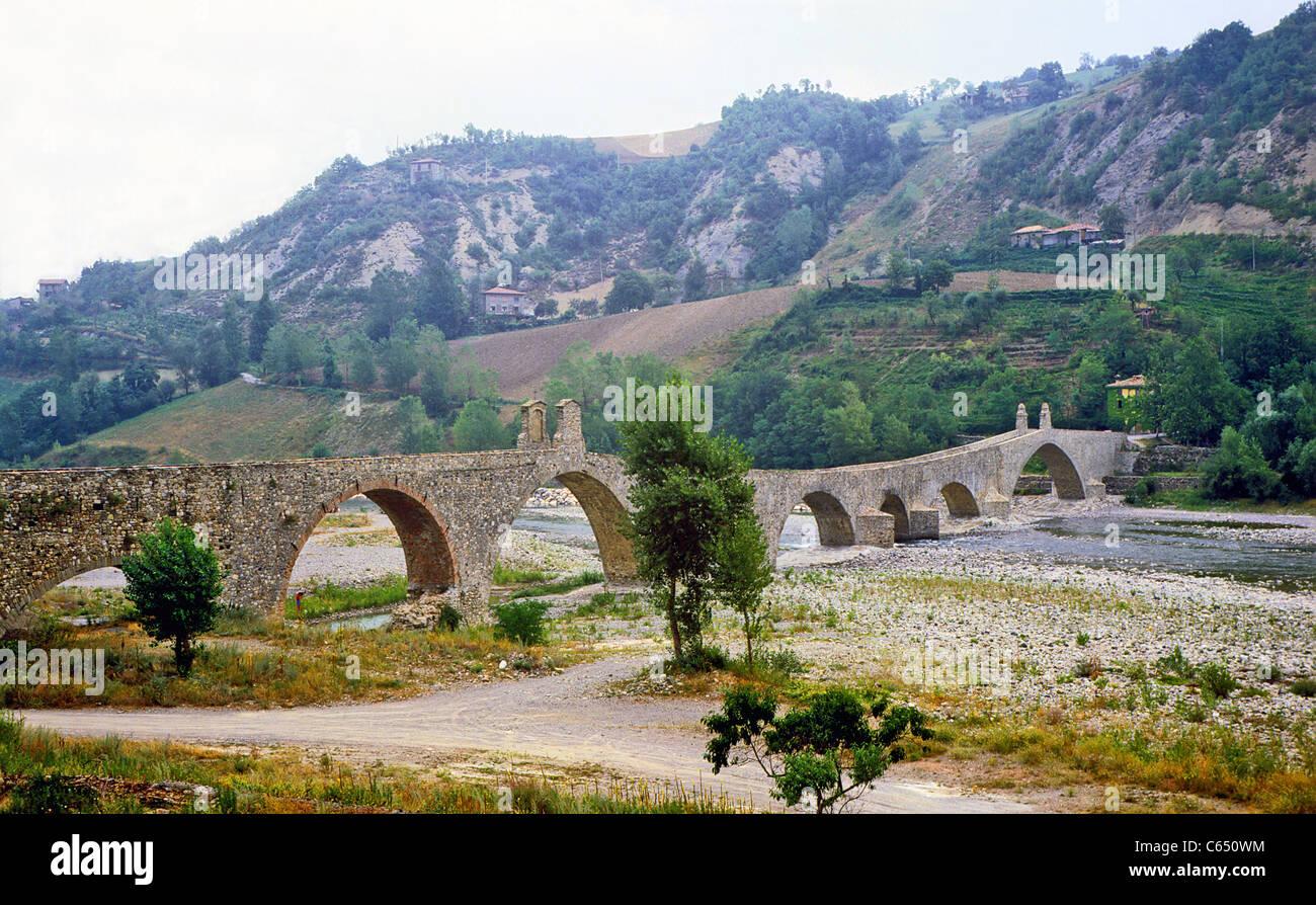 Bobbio.Humpbacked bridge over the river Trebbia. - Stock Image