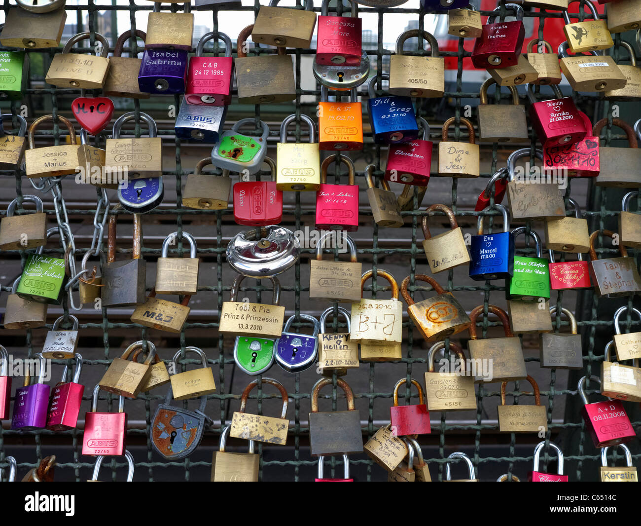 Detail of locks attached to Hohenzollern Bridge by lovers in Cologne Germany - Stock Image