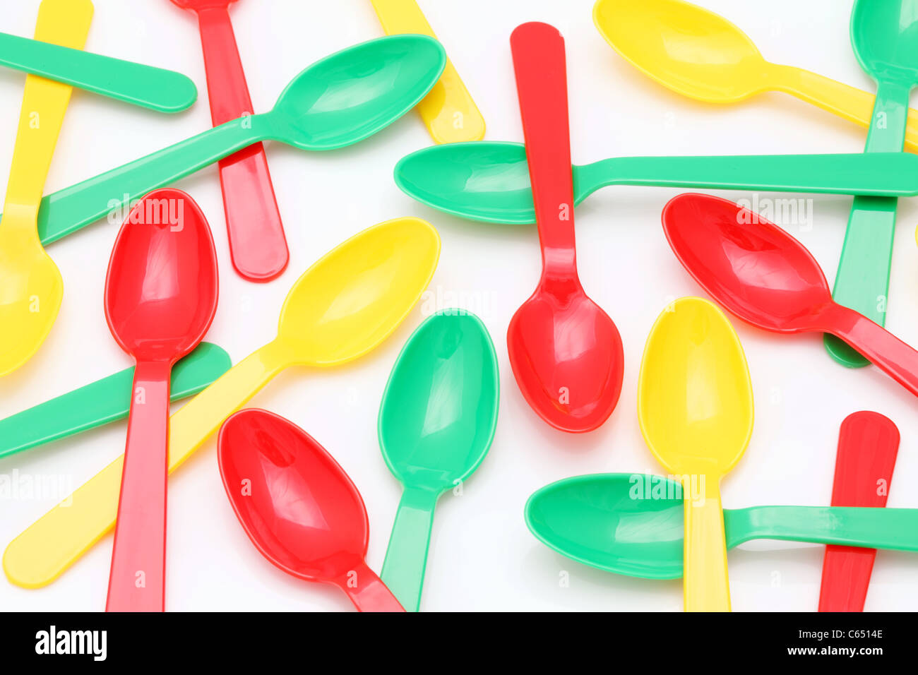 Plastic spoons on a white Stock Photo