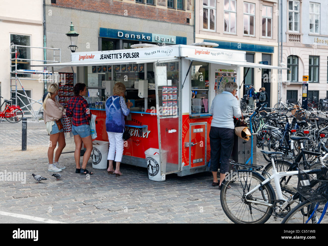 A typical and classic Danish pølsevogn, hot dog stand, on the main pedestrian street,Strøget, Stroeget, - Stock Image