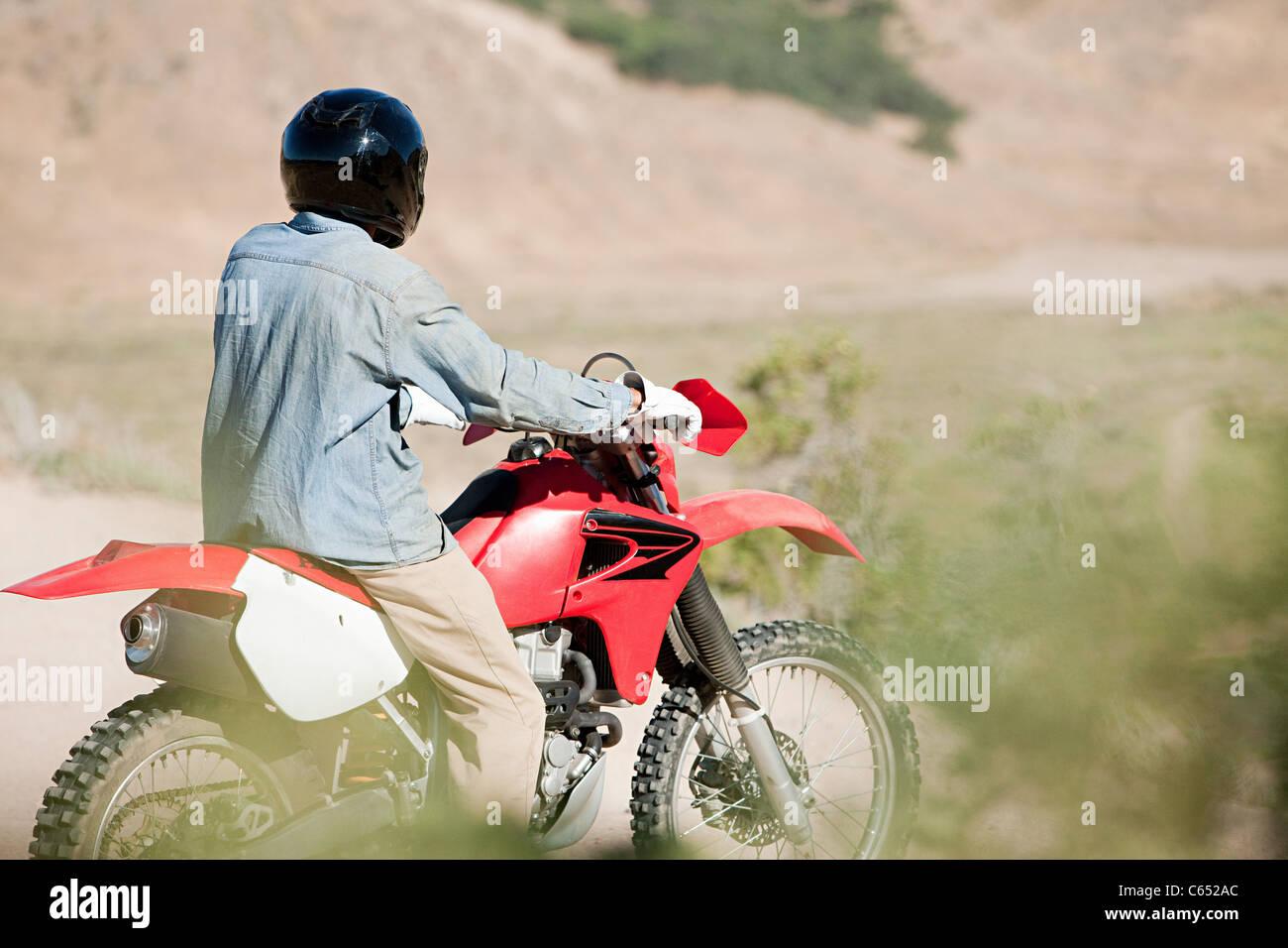 Man riding dirt bike - Stock Image