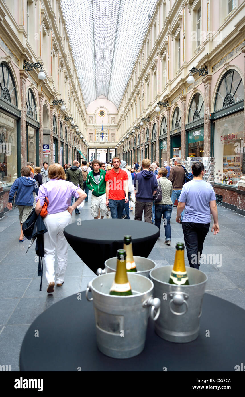 Brussels, Belgium. Galeries St Hubert (1864; J P Cluysenaer - neo-Classical) Champagne bottles in ice buckets - Stock Image