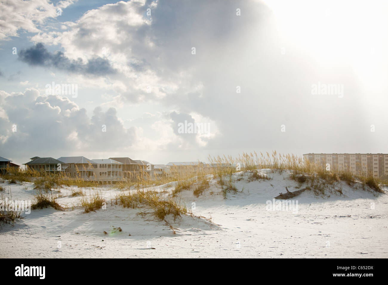 Sand dunes and apartments - Stock Image