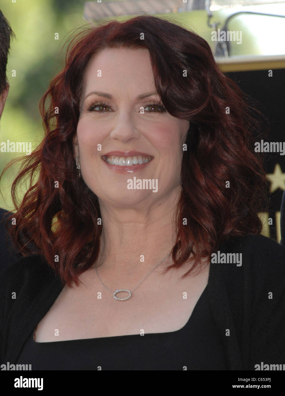 Megan Mullally at the induction ceremony for Star on the Hollywood Walk of Fame Ceremony for Alec Baldwin, Hollywood - Stock Image