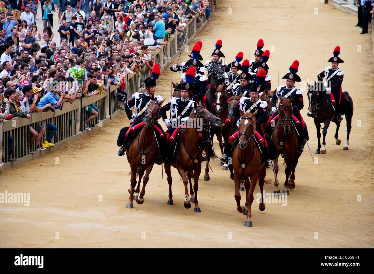 Palio di Siena 2011, July 2. Italian army, Carabinieri; cavalry charge, Piazza del Campo, Palio Siena. Editorial - Stock Image