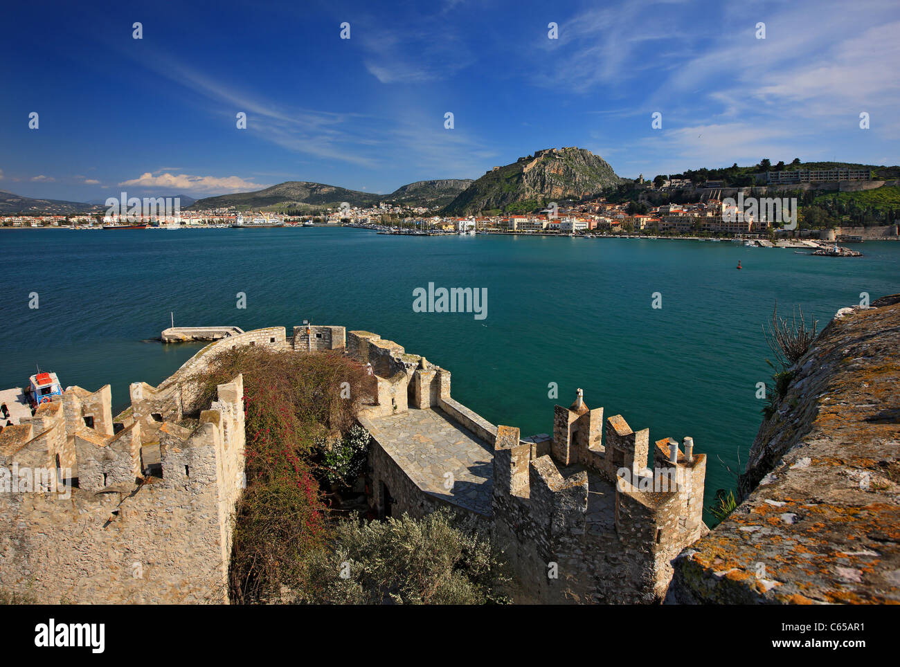 Inside view of Bourtzi castle upon a tiny island, with Nafplio town and Palamidi castle in the background,  Greece Stock Photo
