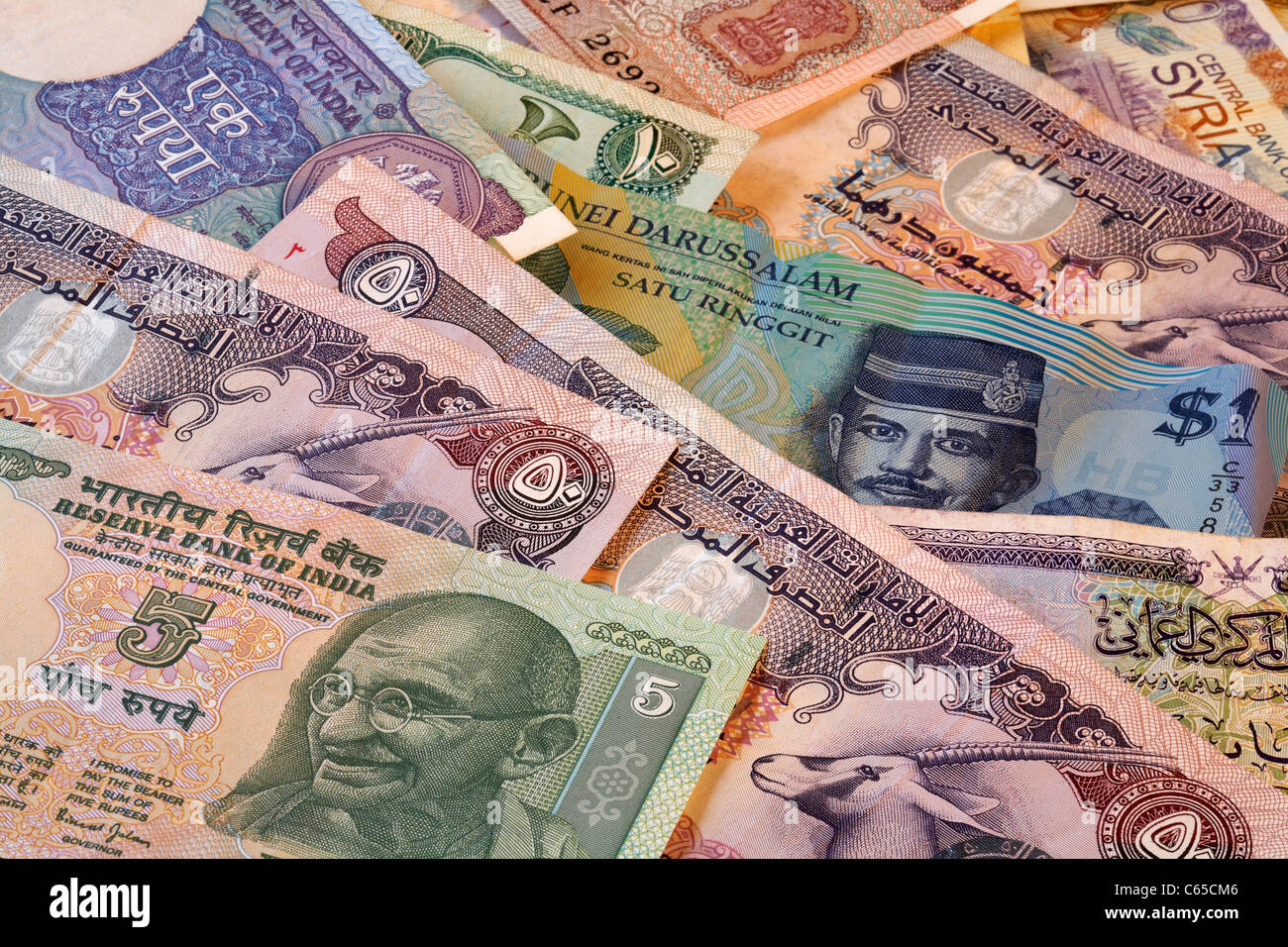 Currency Bank Notes India and Arabic Countries including Brunei, United Arab Emirates, Oman, Syria - Stock Image