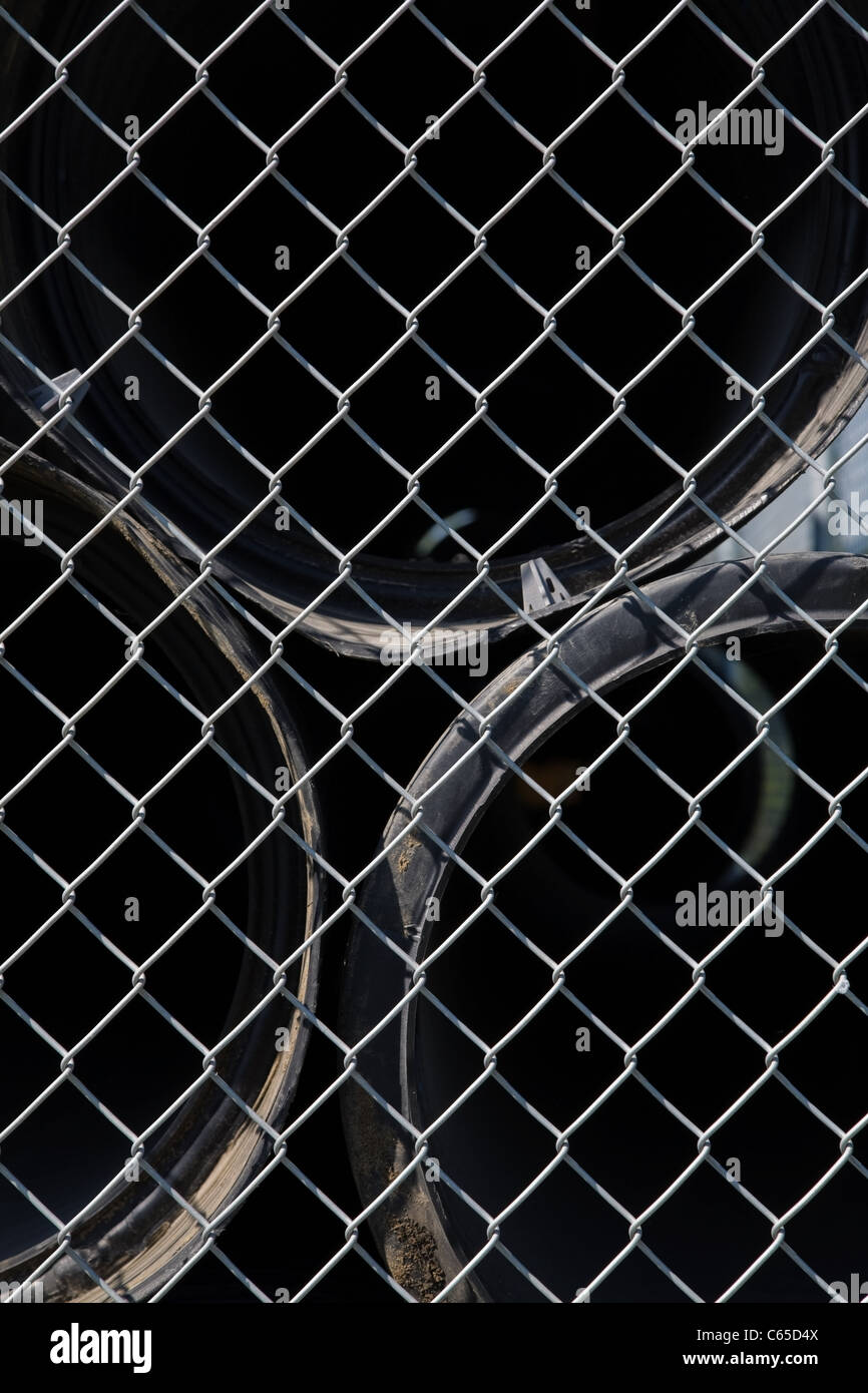 Pipes behind wire mesh fence Stock Photo: 38228762 - Alamy