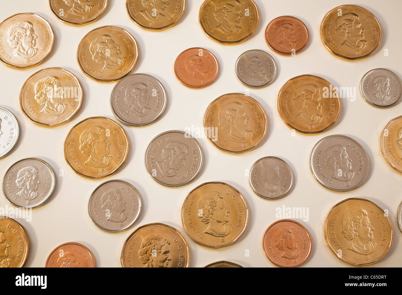 Selection of Canadian coins on white background - Stock Image
