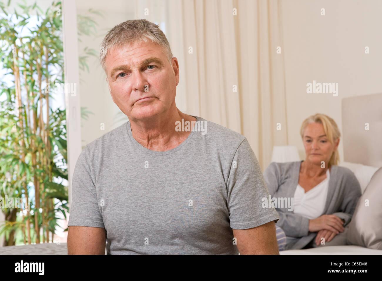 Worried couple in bedroom - Stock Image