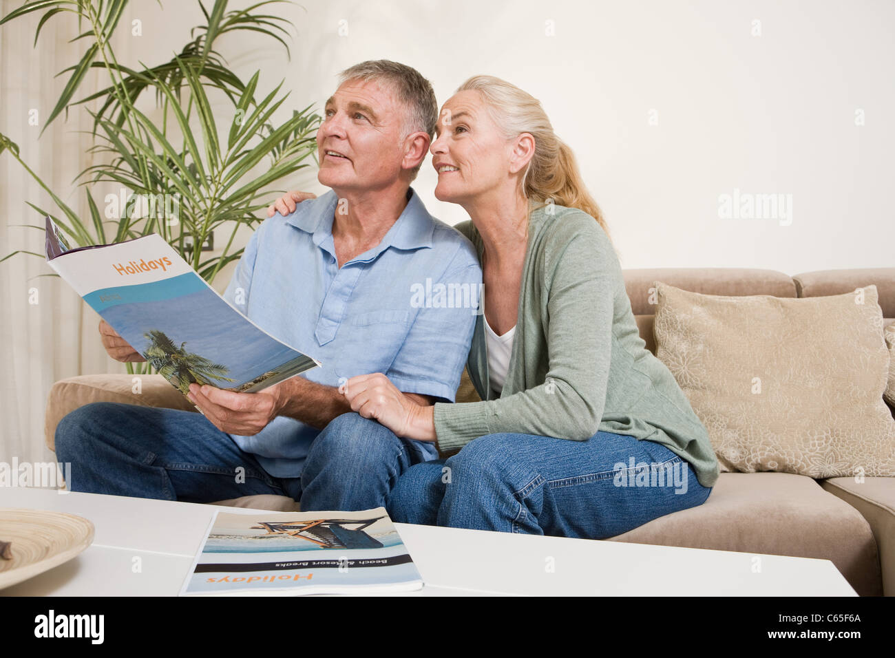 Mature couple planning a holiday - Stock Image