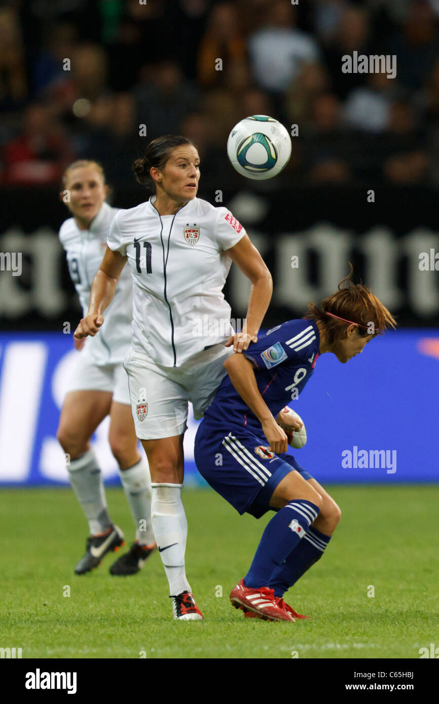 Alex Krieger of the USA (11) and Nahomi Kawasumi of Japan (9) vie for the ball during the 2011 FIFA Women's - Stock Image