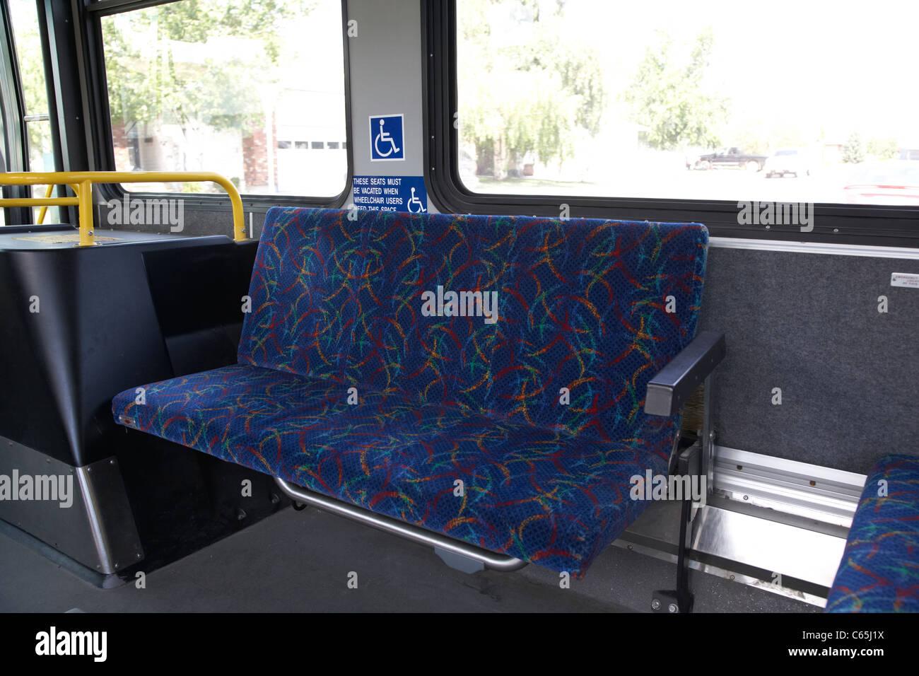 disabled persons seat on board Saskatoon transit bus Saskatchewan Canada - Stock Image