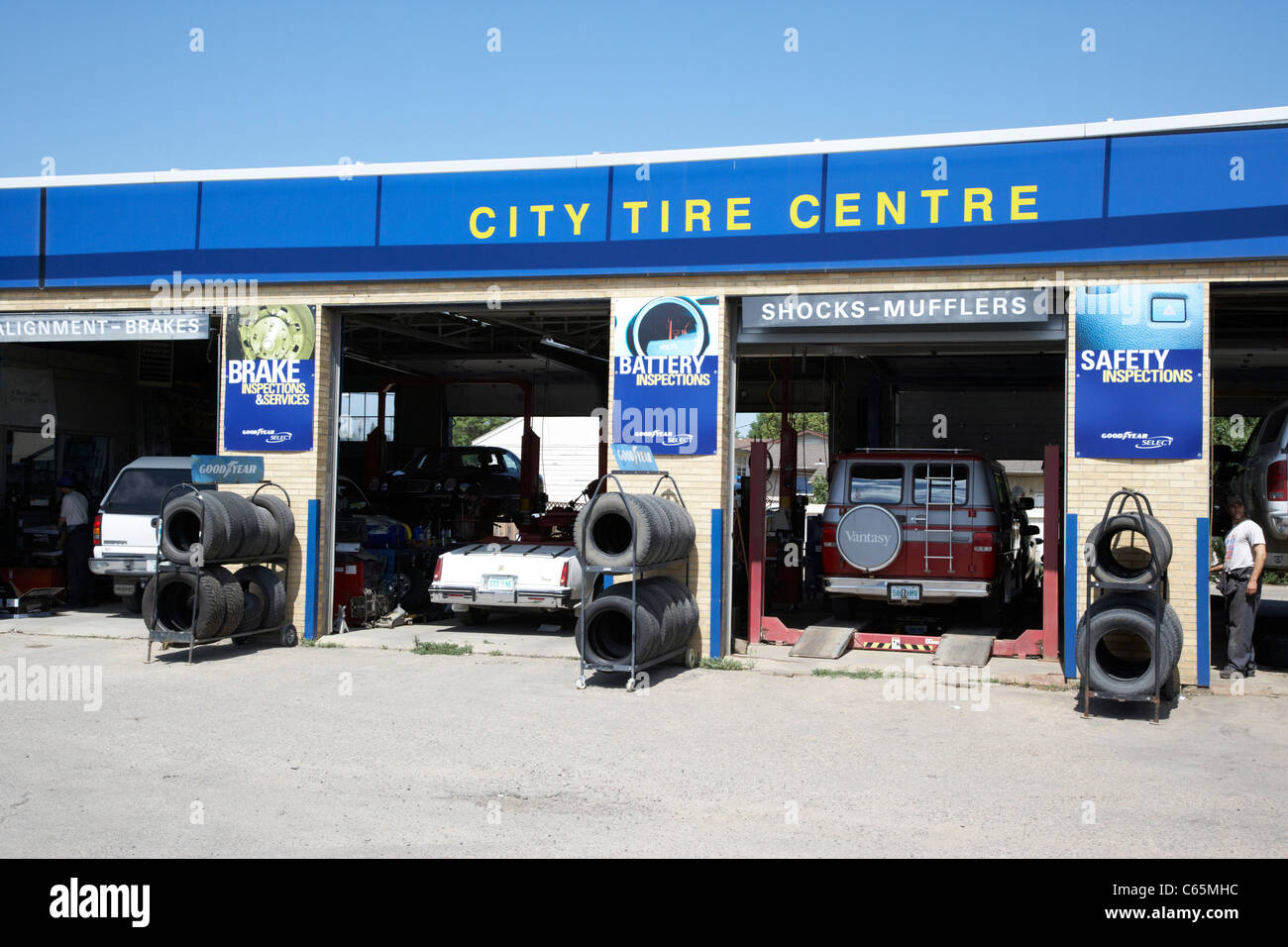 city tire centre drive in car servicing Saskatoon Saskatchewan Canada - Stock Image