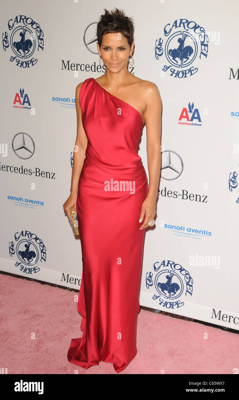 Halle Berry (wearing an Yves Saint Laurent gown) at arrivals for ...