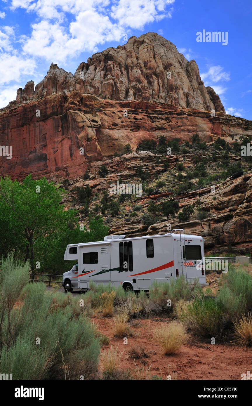 A motorhome camper parked near Capitol Dome, a formation resembling the nation's capitol, in Capitol Reef National - Stock Image