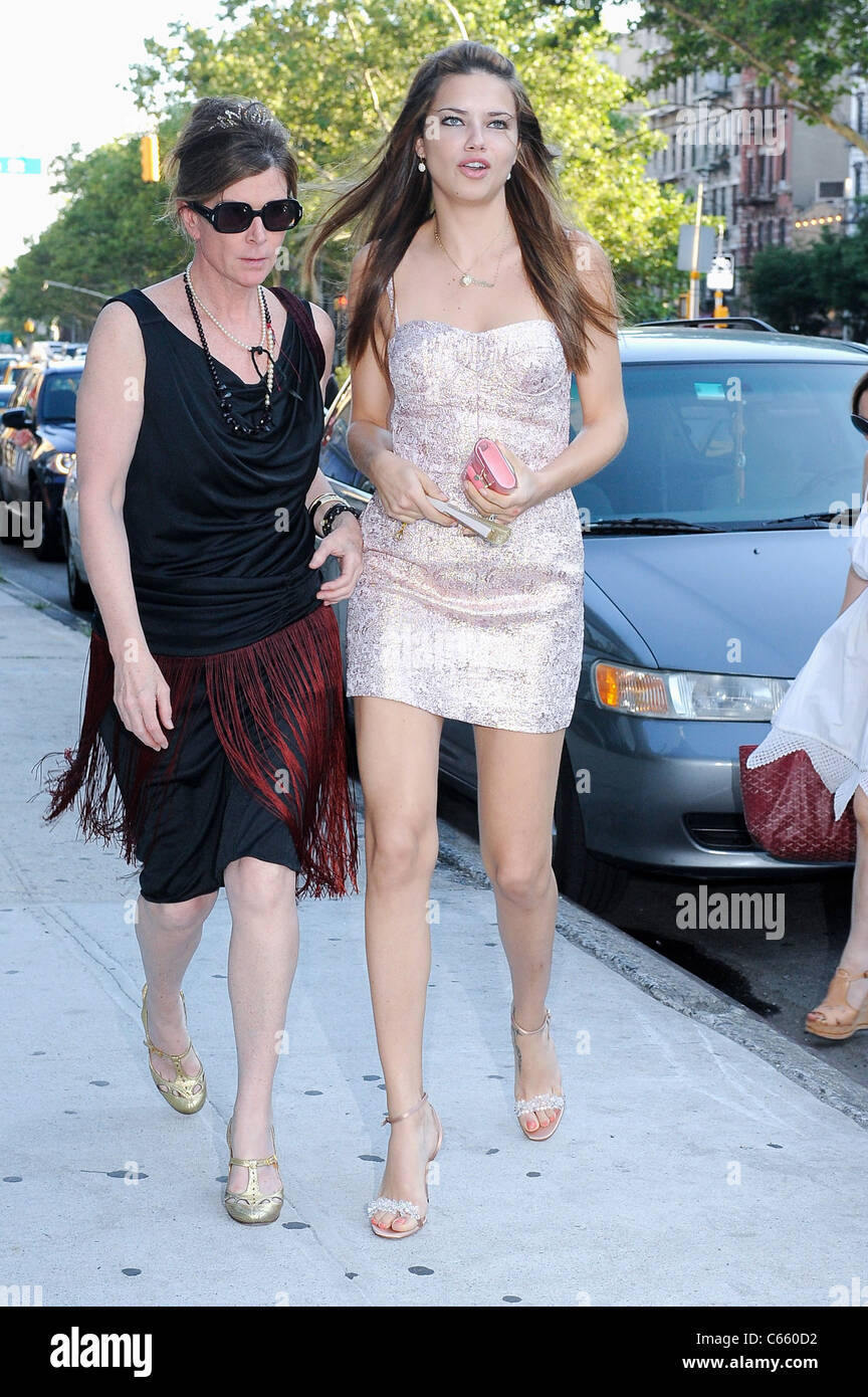 Model Adriana Lima, and guest (L), enter the Thompson Hotel in Soho out and about for CELEBRITY CANDIDS - THURSDAY, - Stock Image