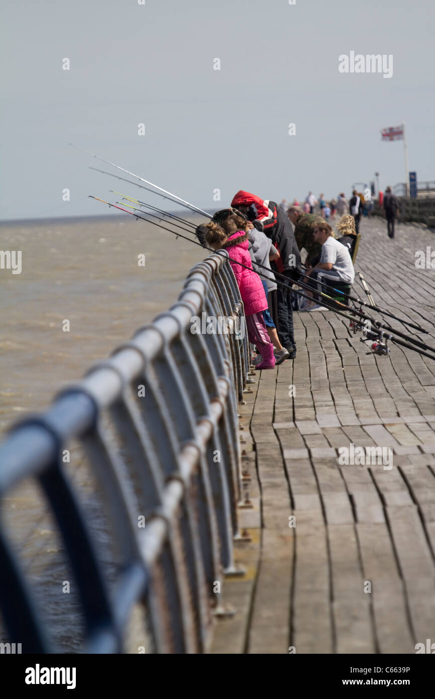 fishing on walton on the naze pier essex - Stock Image