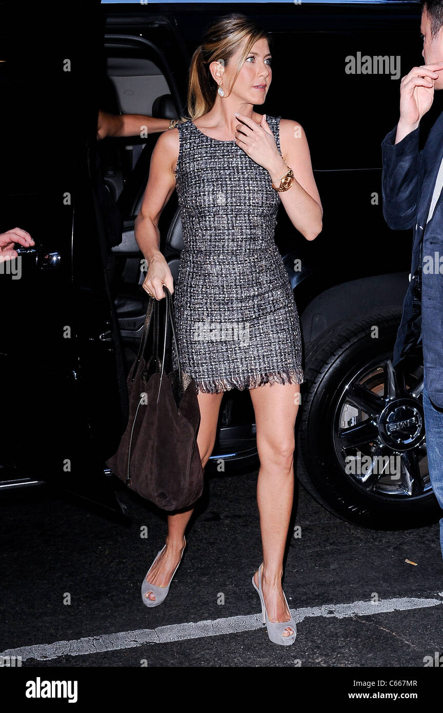 Jennifer Aniston (wearing a Dolce & Gabbana dress),  enters The Lion restaurant out and about for CELEBRITY - Stock Image