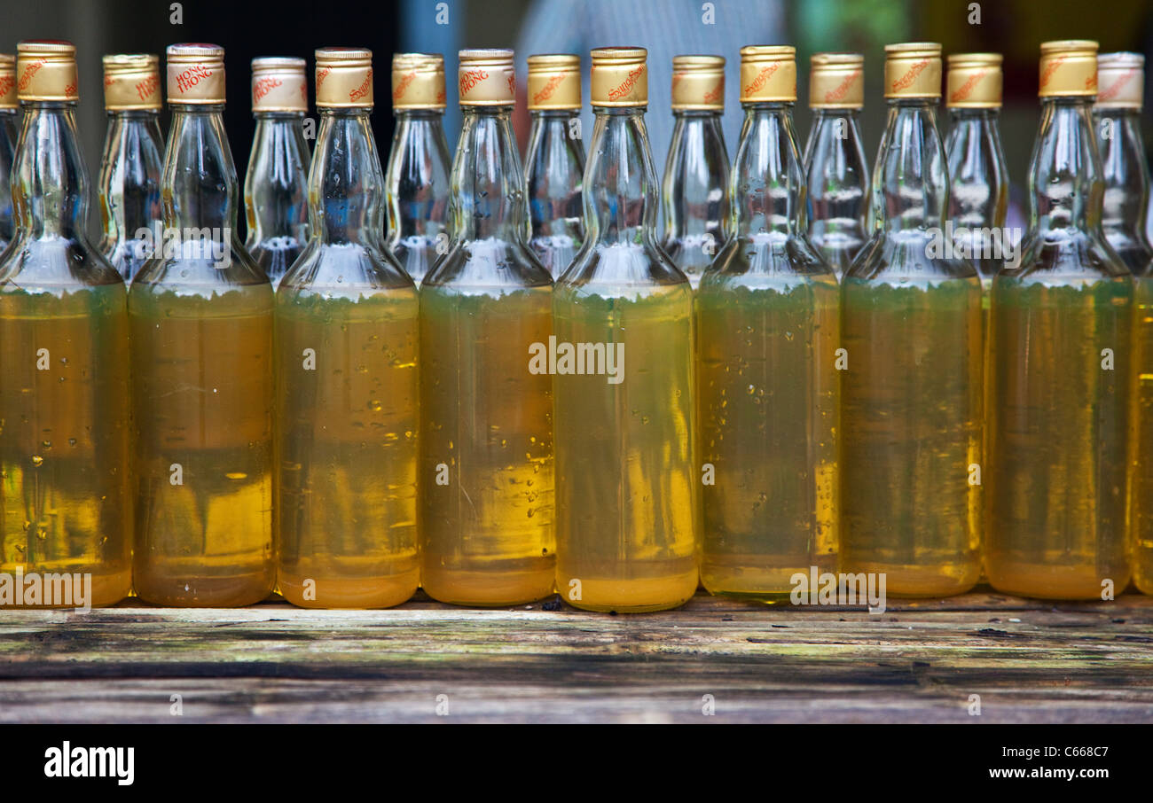 Bottles of Petrol in Thailand - Stock Image