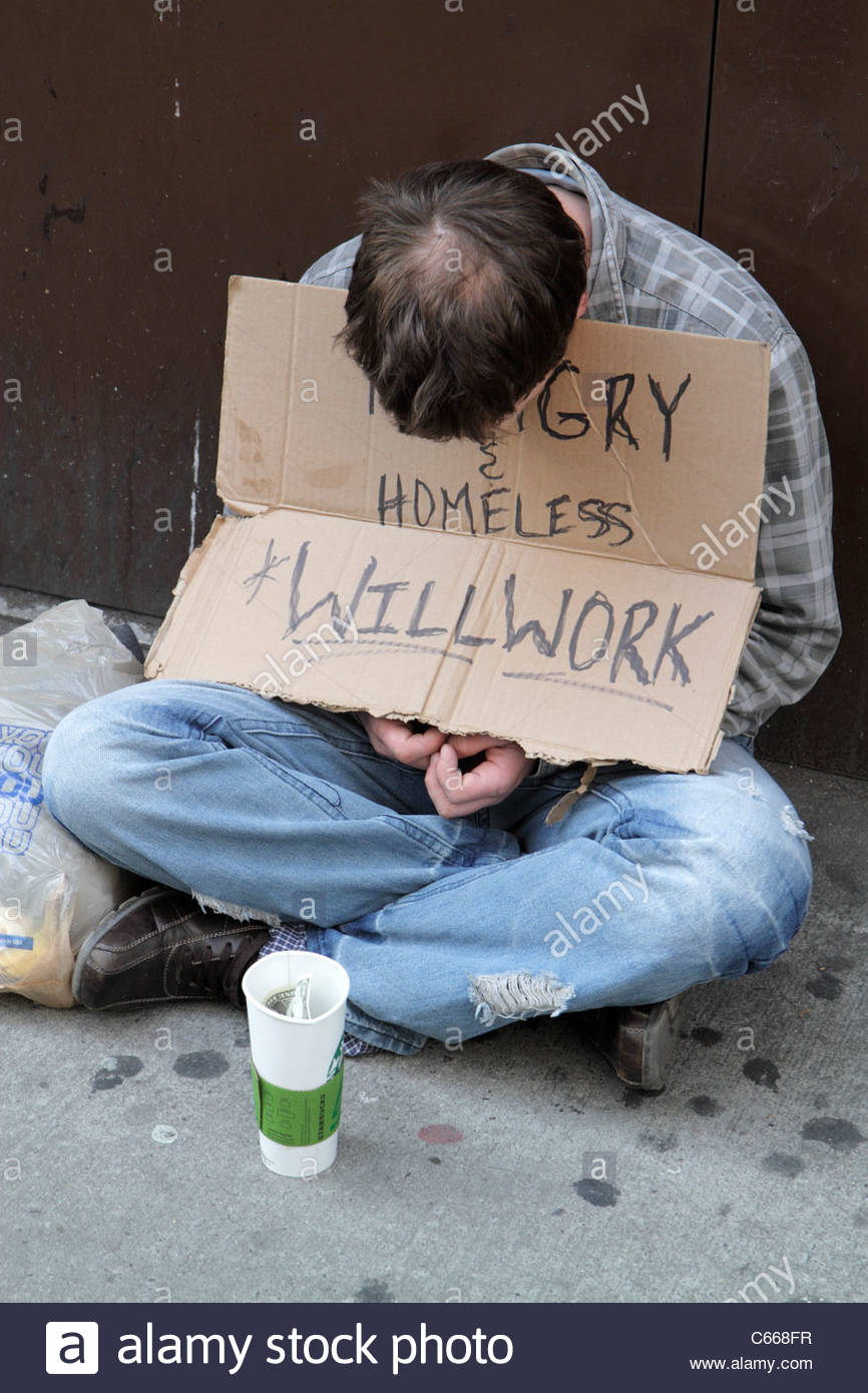 New York New York City NYC Midtown Manhattan 5th Fifth Avenue man vagrant beggar sign homeless hungry will work - Stock Image