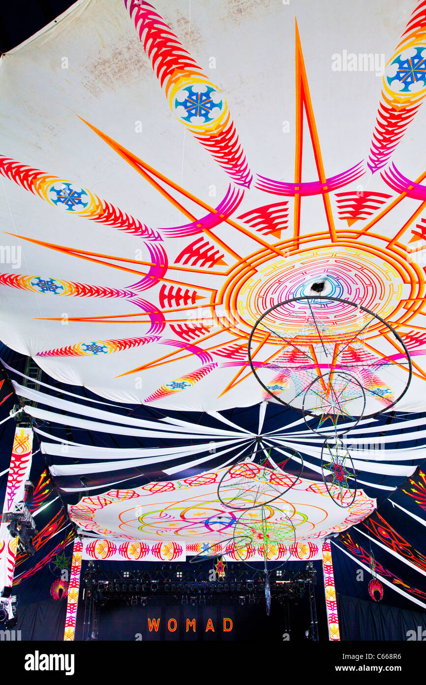 Brightly coloured interior of the Siam Tent, a stage at WOMAD 2011 festival, Charlton Park, Malmesbury, Wiltshire, - Stock Image