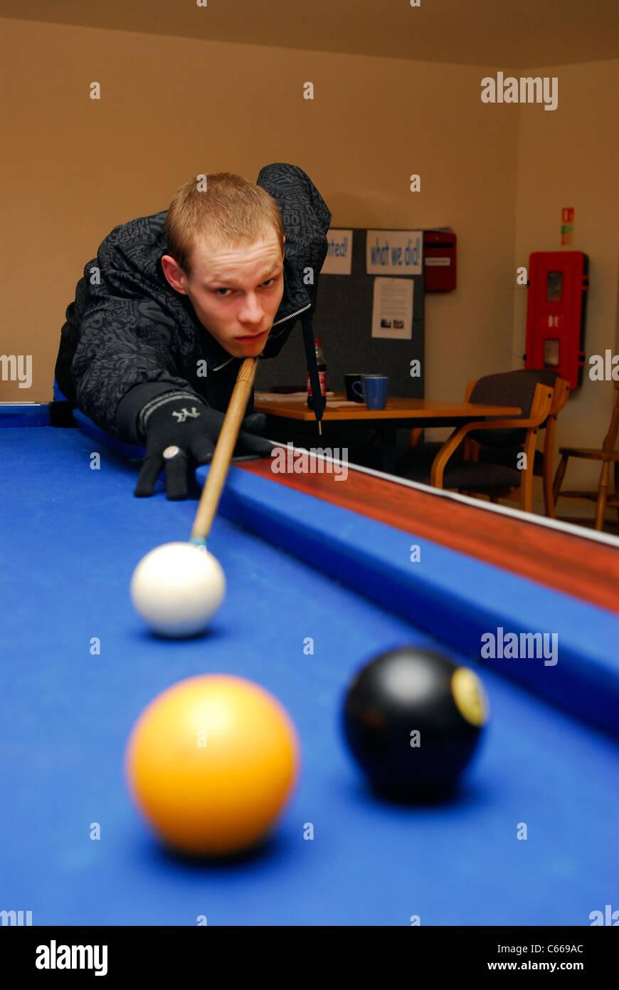 Young man playing pool, Herts, UK. - Stock Image