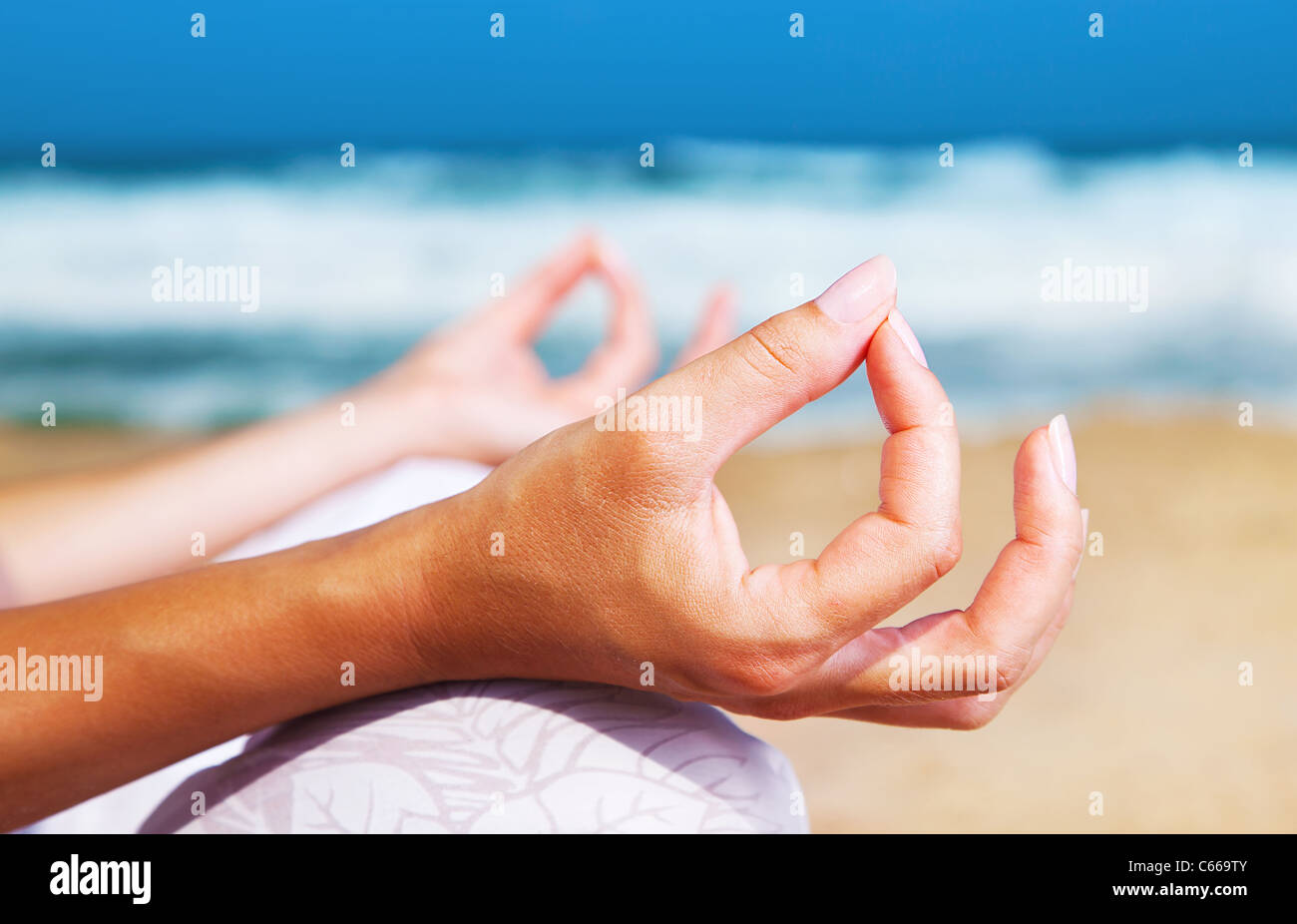 Yoga meditation on the beach, healthy female in peace, soul and mind zen balance concept - Stock Image