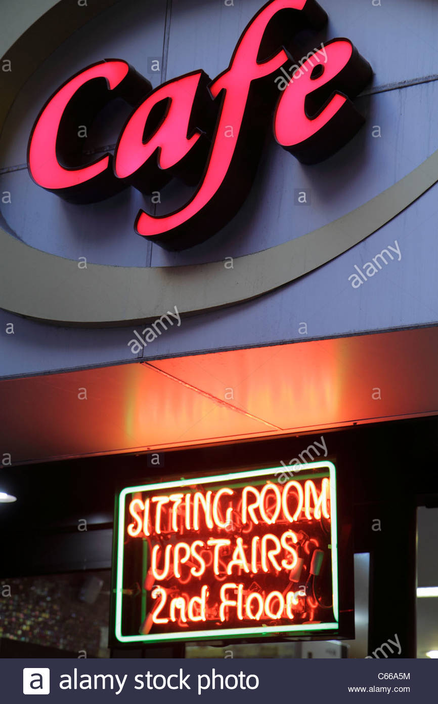 Manhattan New York City NYC NY Midtown 46th Street sign neon cafe second floor upstairs sitting room exterior - Stock Image