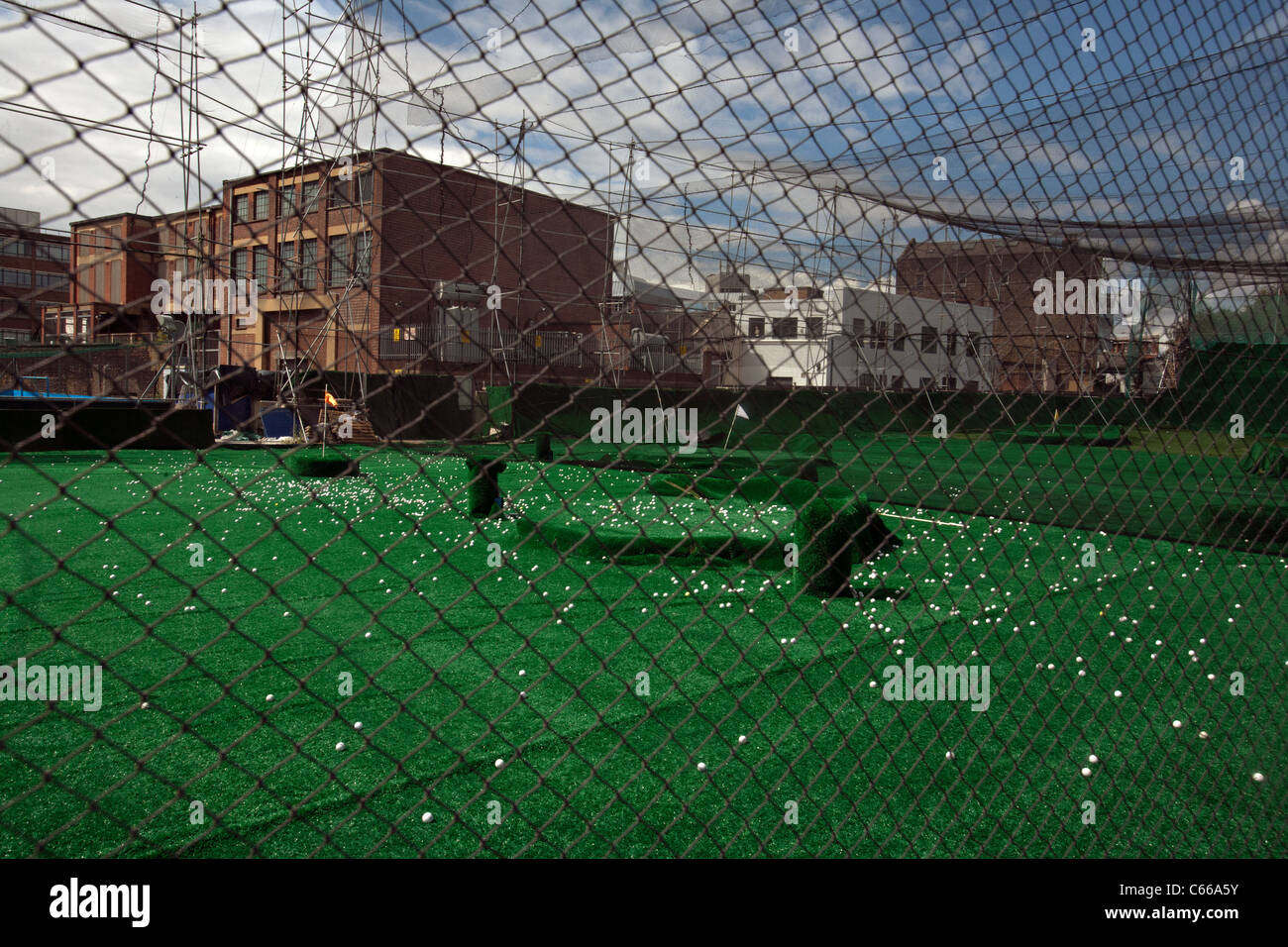 golf driving range in the city of london - Stock Image