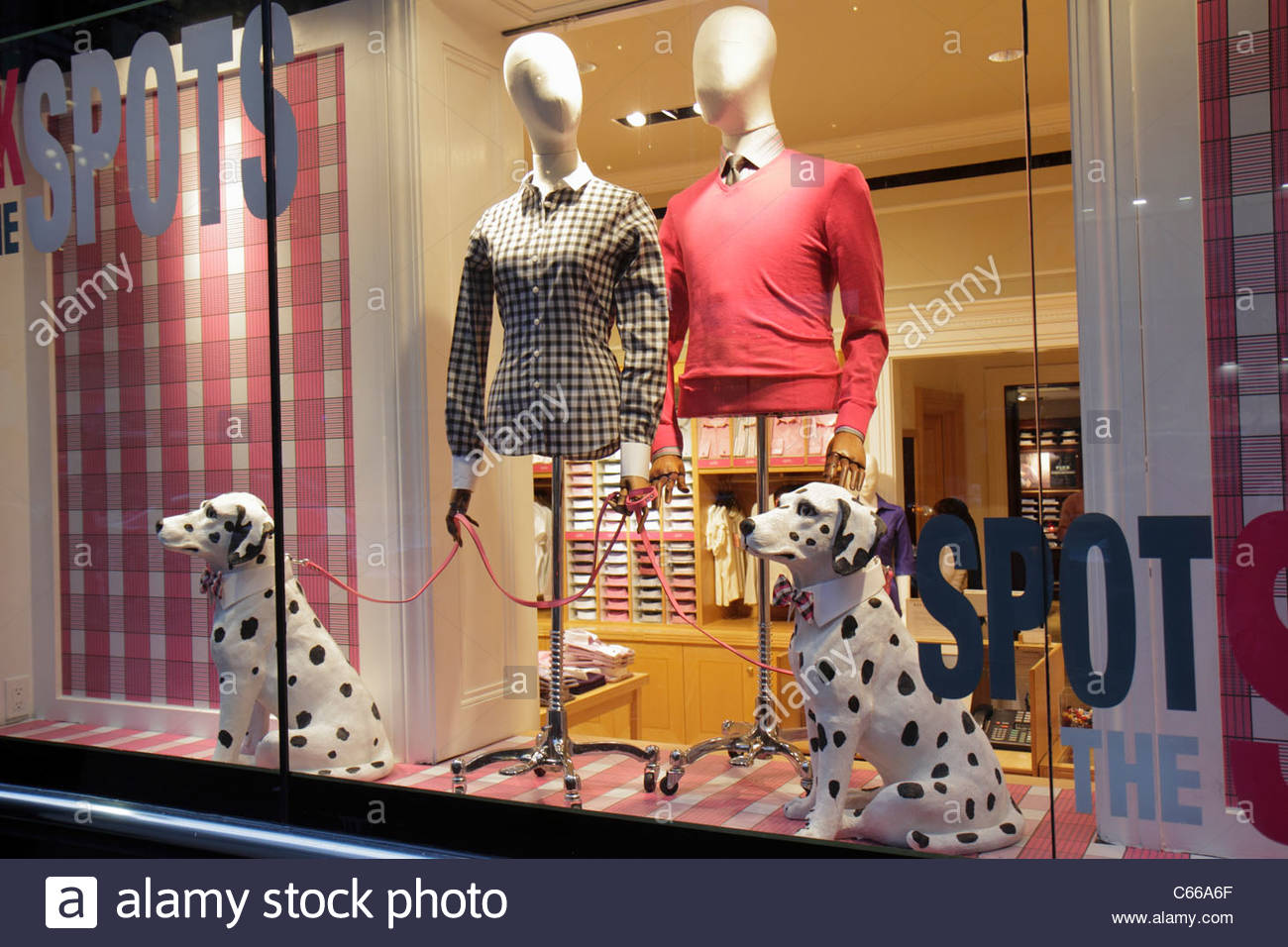 Manhattan New York City NYC NY Midtown 42nd Street business boutique fashion store window mannequin apparel Dalmatian - Stock Image