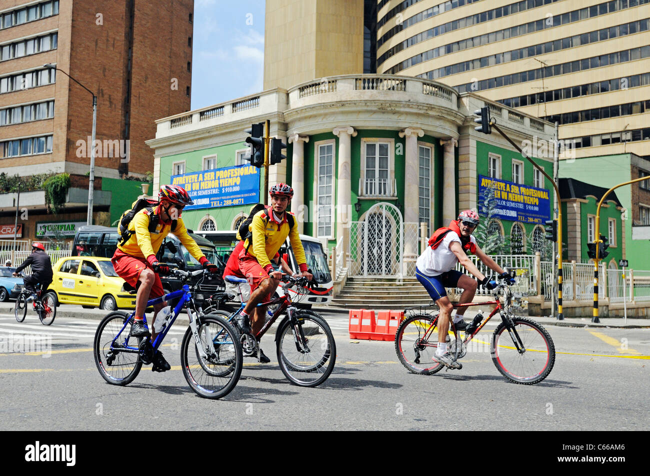 Ciclovia, people on bikes on sunday, when streets closed to cars, Bogotá, Colombia - Stock Image