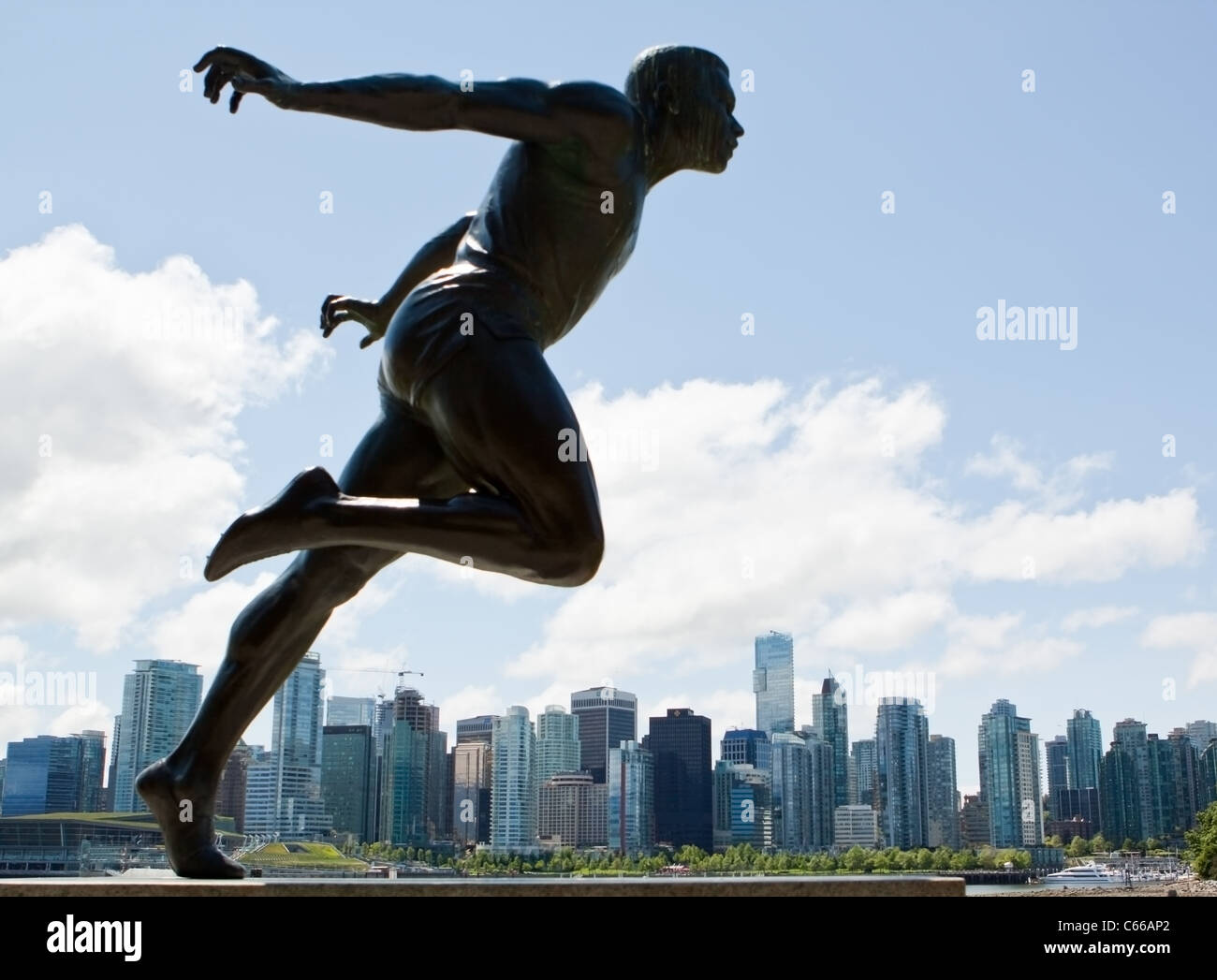 Bronze Statue of Track and Field Athlete Harry W Jerome in Stanley Park Vancouver Canada - Stock Image