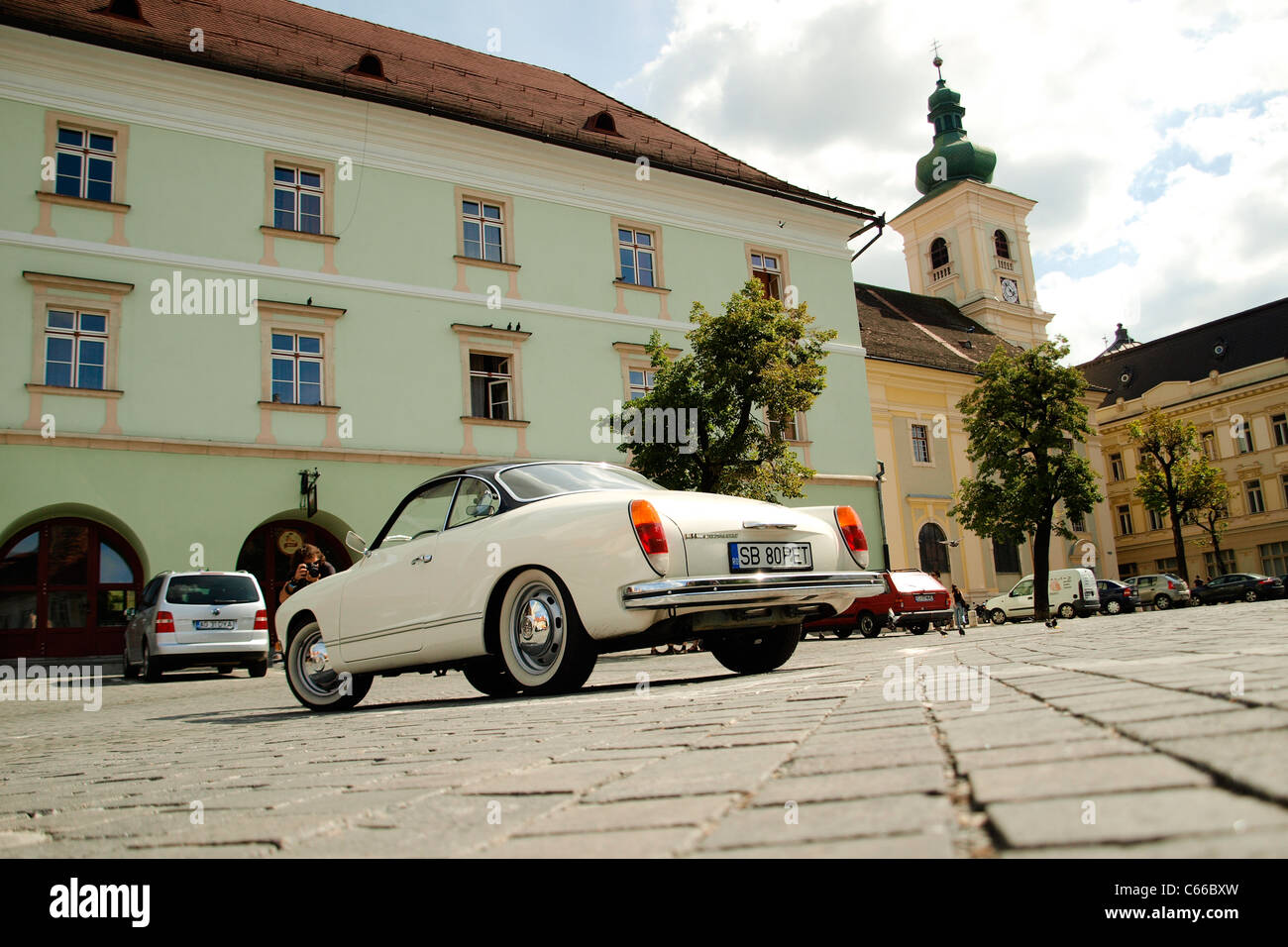 Old car parked inc enter. - Stock Image
