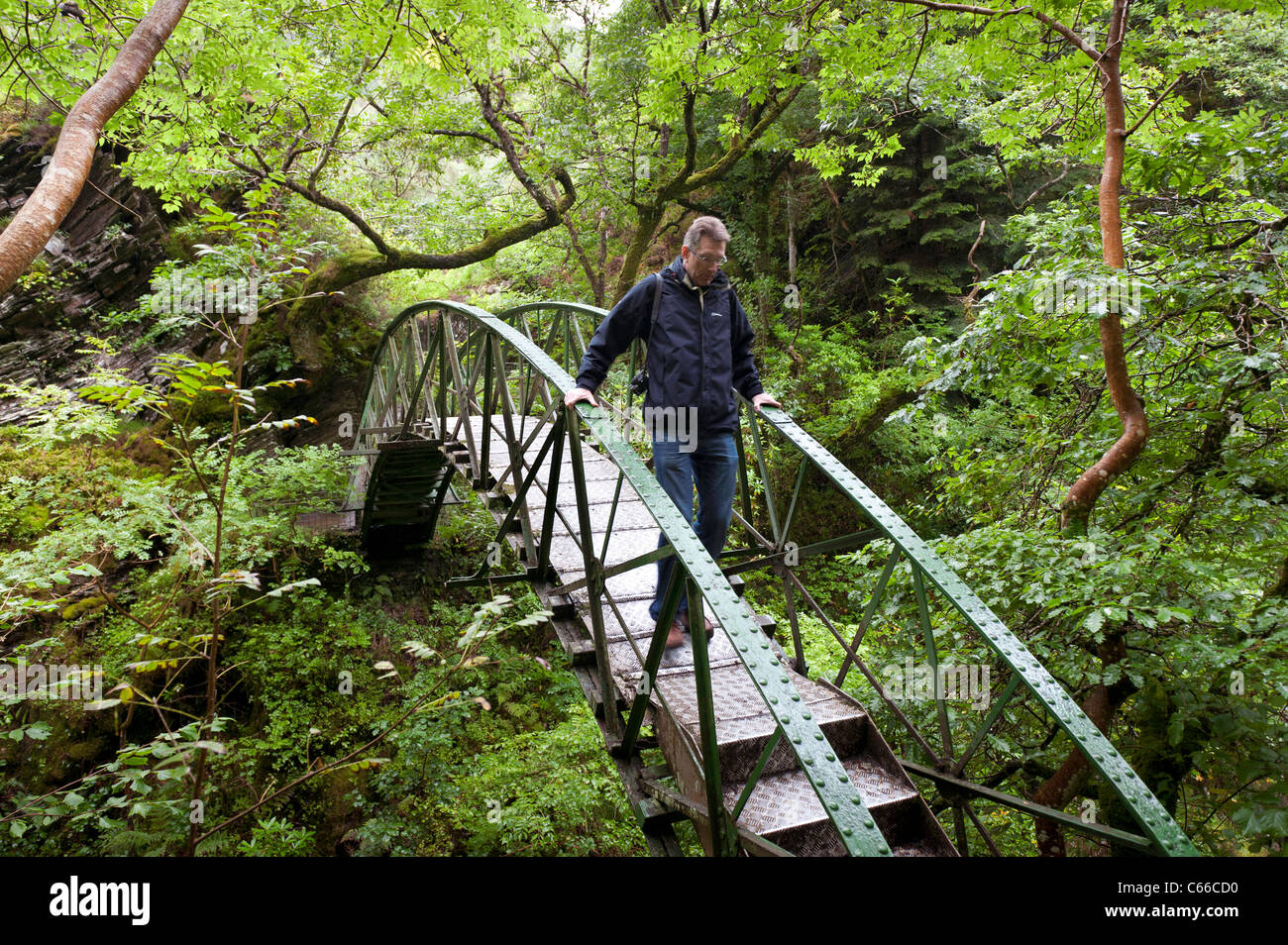 Arched metal bridge at Devils Bridge tourist attraction - inspiration to Wordsworth for 'To the Torrent at Devils - Stock Image