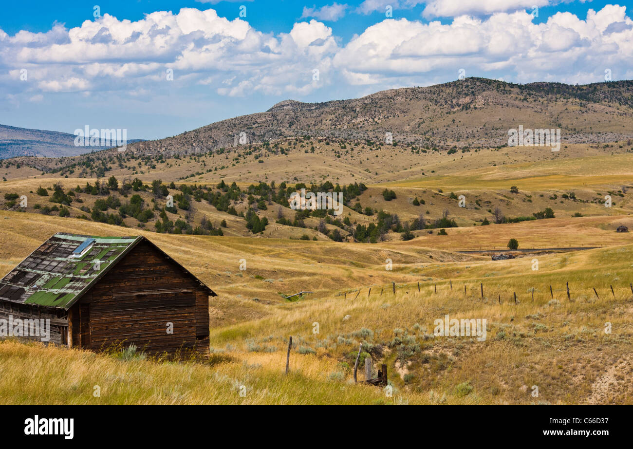 Farm lands and cabin along Montana road 359 south of Butte, Montana. - Stock Image