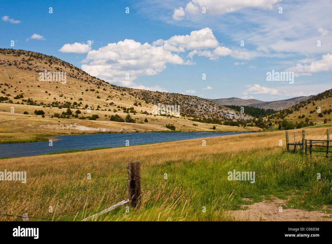 Farm lands and lake along Montana road 359 south of Butte, Montana. - Stock Image