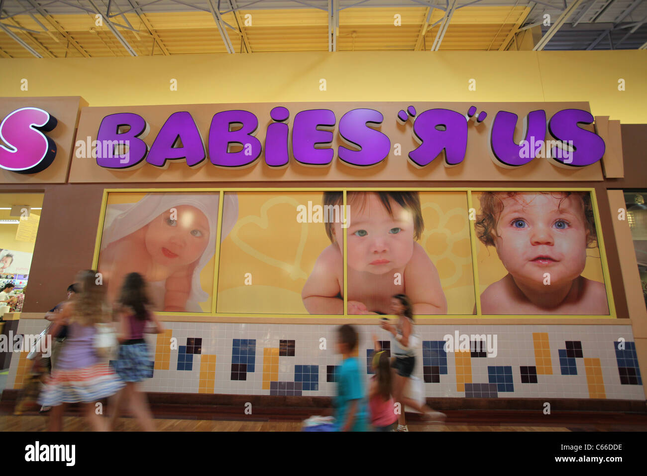 'Babies r us' poster outside a Toys r us store in Vaughan mills mall, Toronto - Stock Image