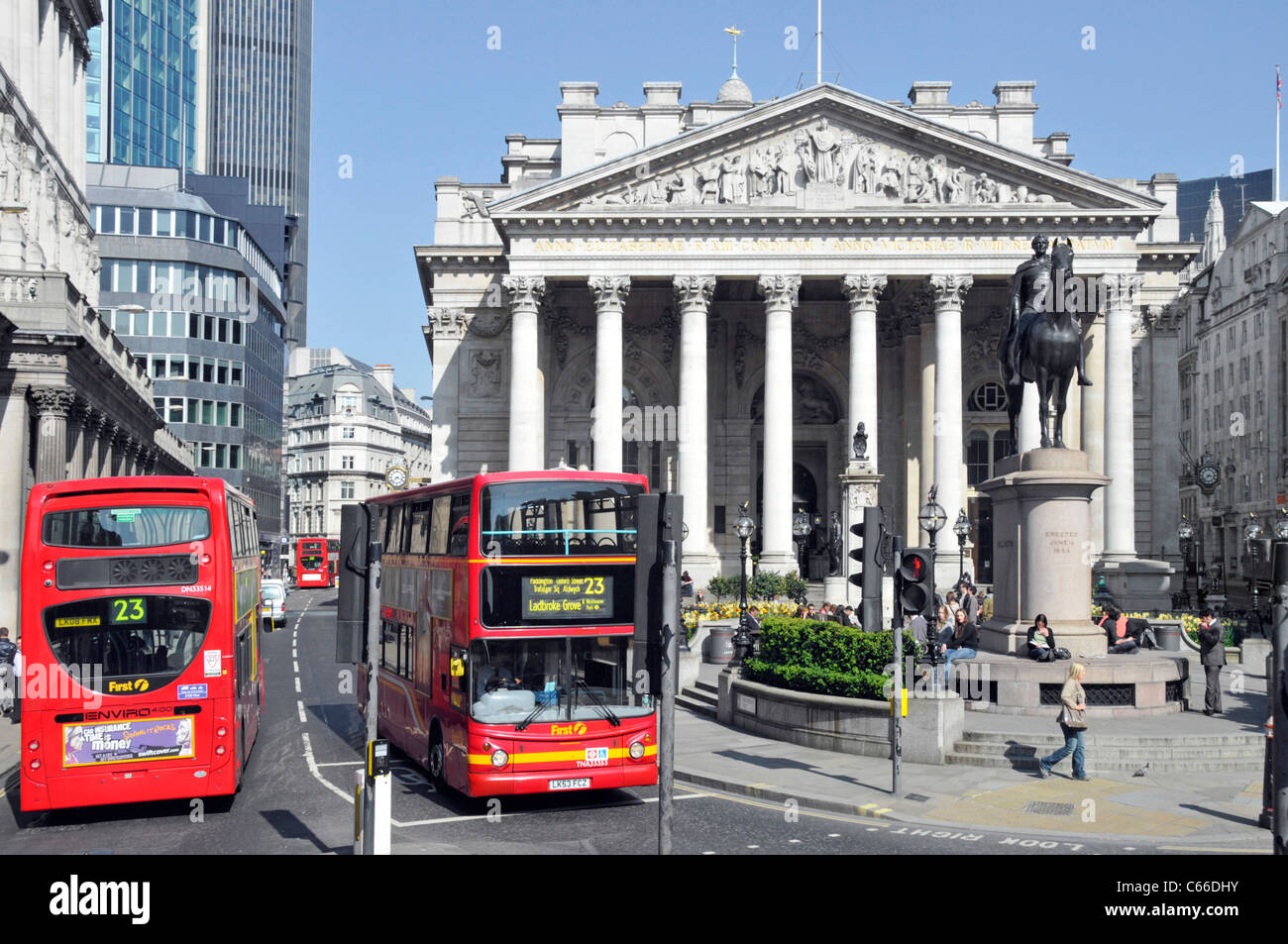 London public transport buses in Threadneedle Street in Square Mile of City of London with The Royal Exchange building - Stock Image