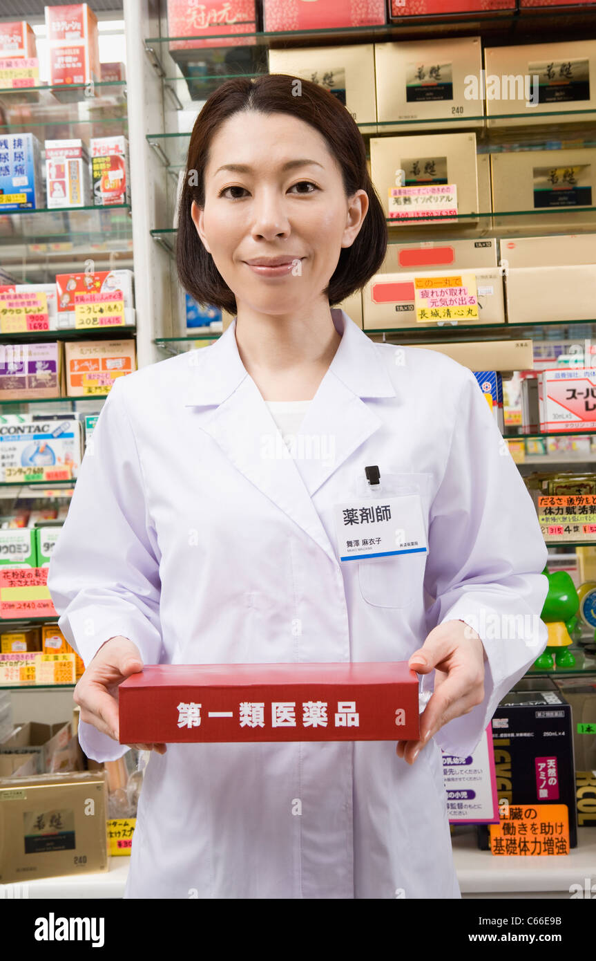 Pharmacist Holding Box of Type-1 OTC Drugs - Stock Image