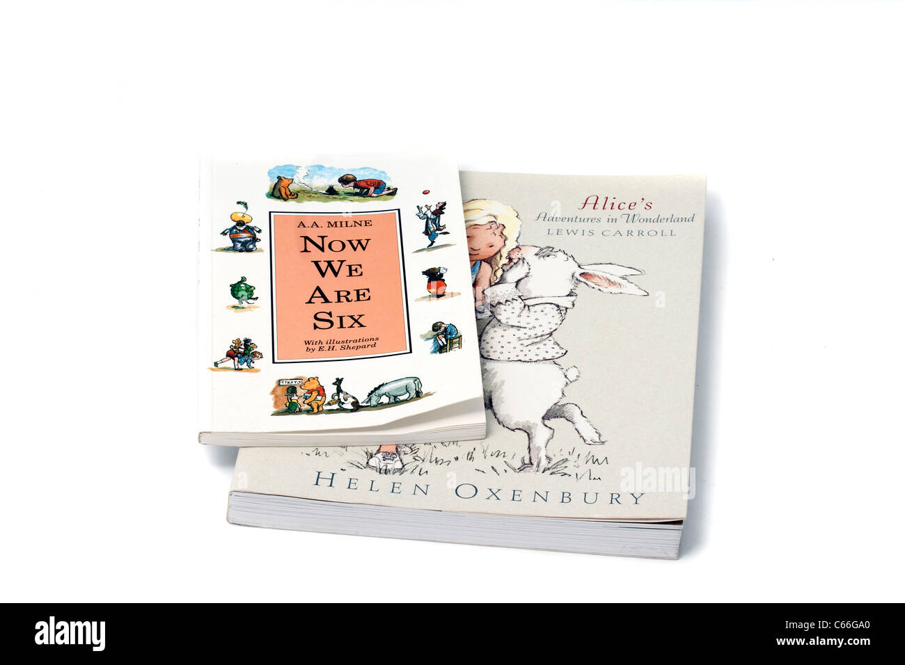 A.A. Milne Now we are Six, and Lewis Carroll's Alic in Wonderland. Two timeless and charming children's - Stock Image