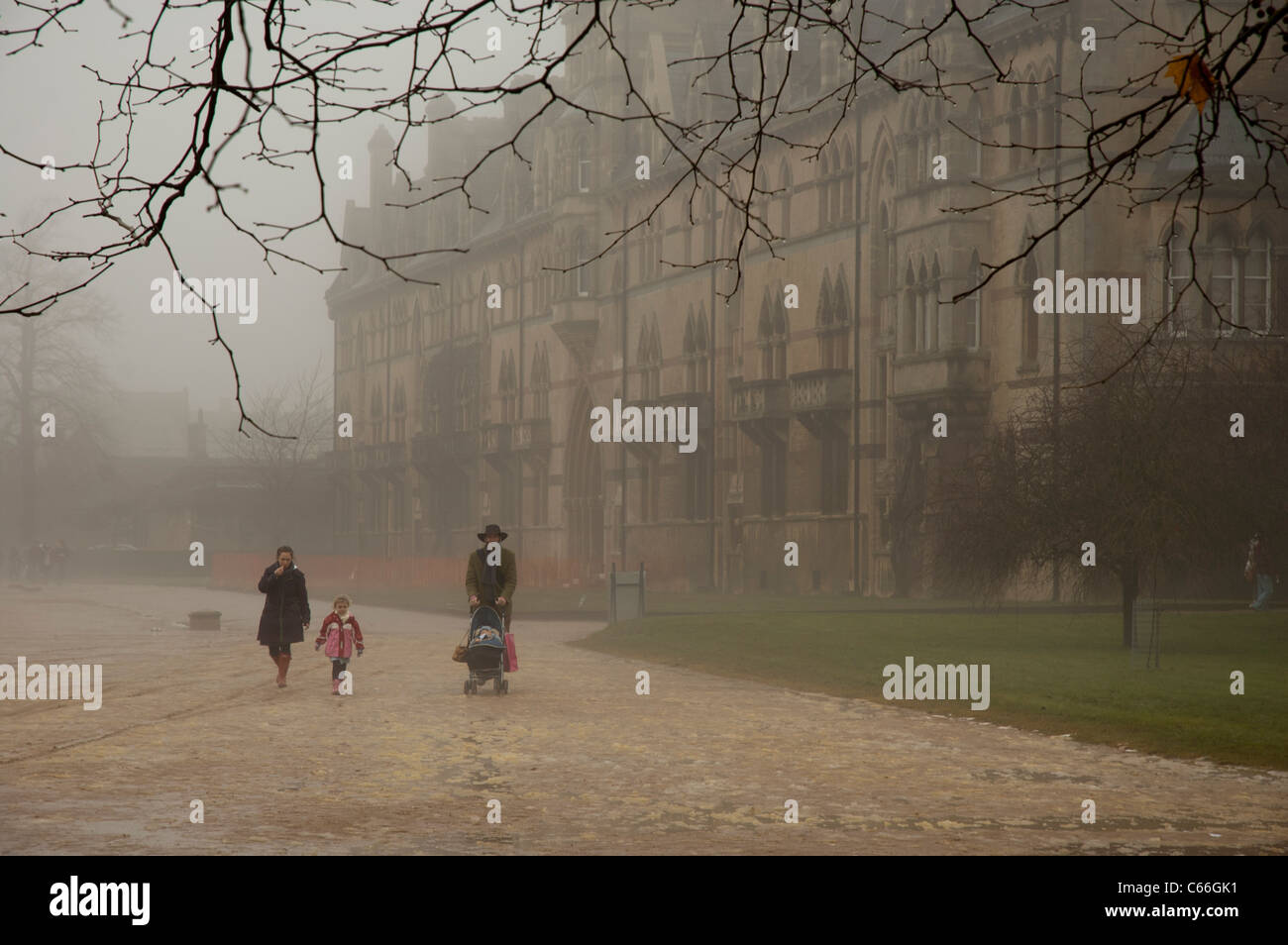 Family walking in Fog in Christ Church Meadow, Oxford, England - Stock Image