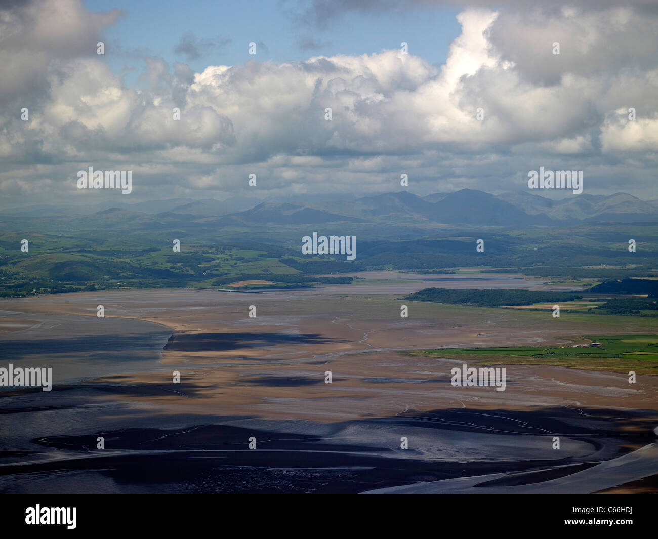 Morcambe Bay, North West England, from the air looking north to the distant Lake District Mountains - Stock Image