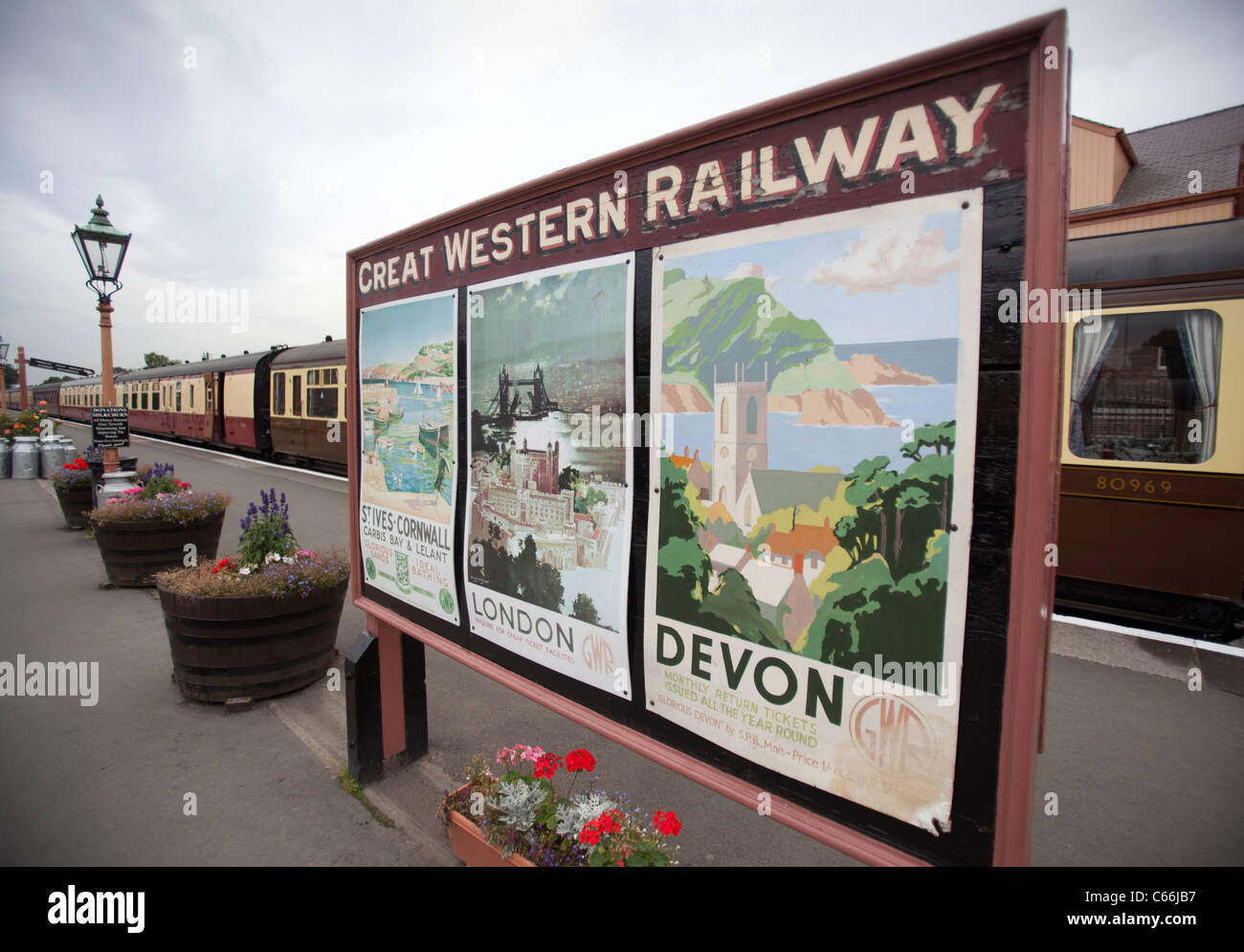 Old Great Western Railway posters on the platform of the Severn Valley Railway station at Kidderminster, England. - Stock Image