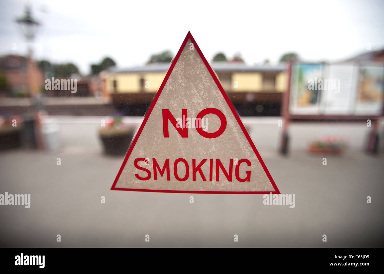 A 'no smoking' sign on the window of an old steam train carriage, Kidderminster, UK. - Stock Image