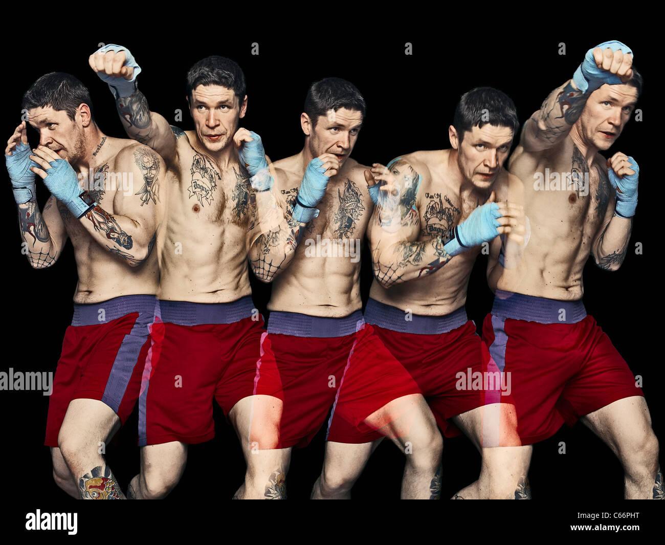 Multiple exposure of boxer punching Stock Photo